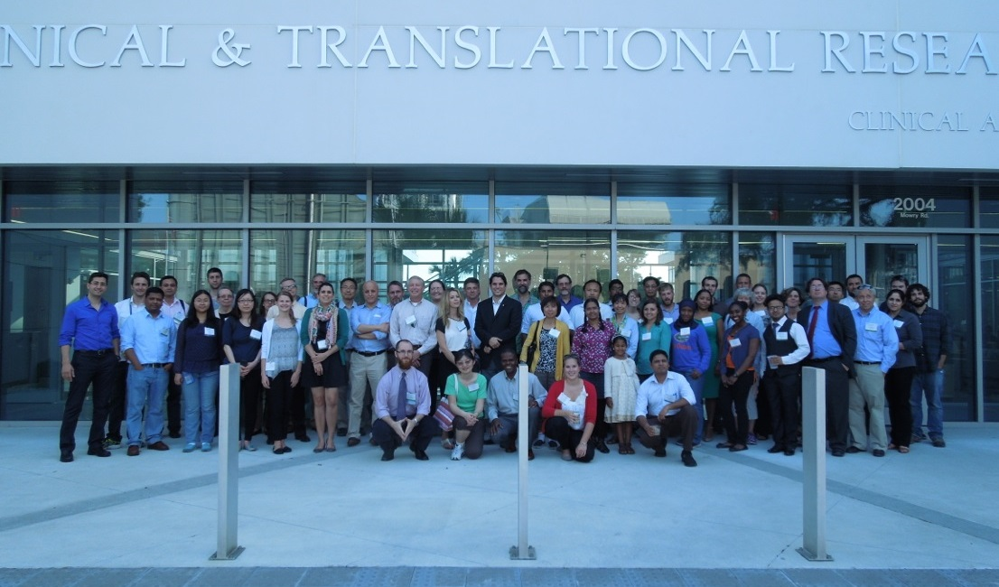 Speakers and attendees of the 2014 UF Workshop & Symposium stand outside the University of Florida's Clinical & Translational Research Building on Wednesday, May 21, during the event's BBQ Dinner and Welcome Reception.